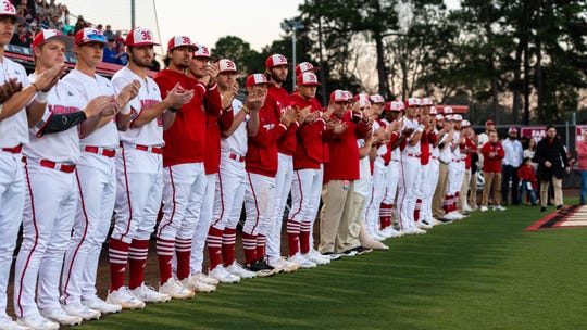 """The Cajuns baseball team wears """"36"""" caps in honor of former coach Tony Robichaux, who died July 3, 2019."""
