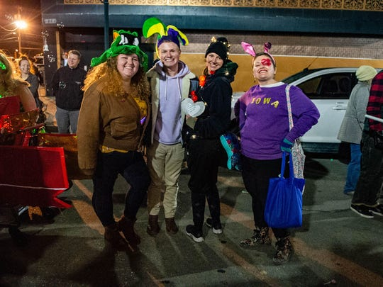 Victoria Dodge, second from the right, as she and colleagues join the Krewe de Canailles on Friday as an alligator, jester, catfish and rabbit.