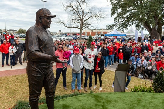 Members of the Robichaux family look on after a statue of late Ragin' Cajuns Tony Robichaux was unveiled Saturday.