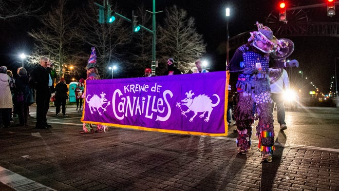 The Krewe de Canailles paraded through Downtown Lafayette Friday, Feb. 14, 2020.