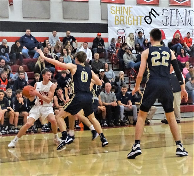 Fairfield Union's Ryan Magill looks for an open team while being double-teamed by Teays Valley defenders Friday night during the Falcons' 45-43 overtime win.