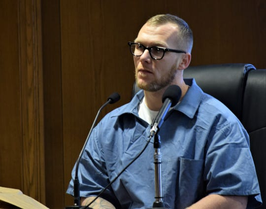 Joshua Landis sits at the witness stand during Chad Kerens' murder trial Feb. 14. Kerens is accused of killing one man and tampering with the scene. Landis was called as a witness to testify on the victim's character, attesting it was violent.