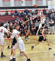 Fairfield Union senior Chase Poston shoots a jumper over a Teays Valley defender during the Falcons' 45-43 overtime win Friday night.