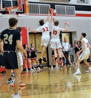 Fairfield Union's Andrew Moll and Charlie Bean combine to block a Teays Valley shot during the Falcons' 45-43 overtime win Friday night.