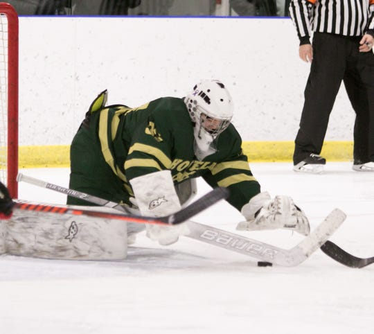 Howell goalie Ean Badgett makes one of his 20 saves in a 5-1 victory over Canton on Friday, Feb. 14, 2020.