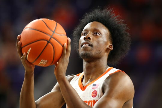 Clemson Tigers guard John Newman III (15) shoots a free throw during the first half against the Louisville Cardinals at Littlejohn Coliseum in Clemson, South Carolina, on Saturday, Feb. 15, 2020.