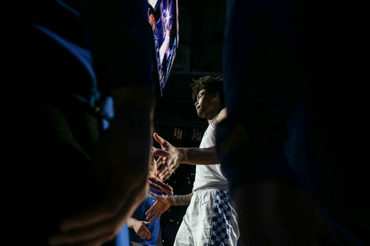 Kentucky's Nick Richards walks towards the court during player announcements before the game against Ole Miss at Rupp Arena. Feb. 15, 2020