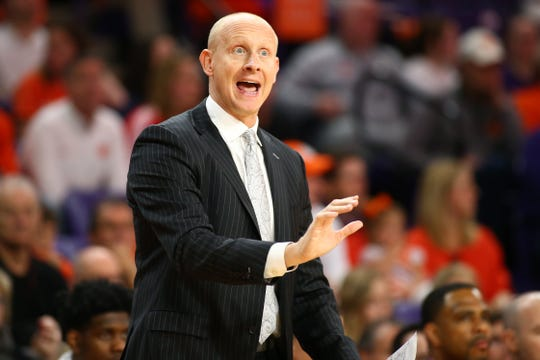 Louisville Cardinals head coach Chris Mack gives directions during the first half against the Clemson Tigers at Littlejohn Coliseum in Clemson, South Carolina, on Saturday, Feb. 15, 2020.