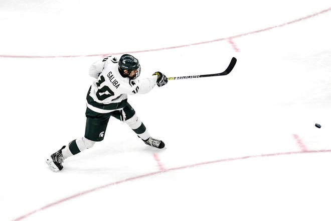 Michigan State's Sam Saliba takes a shot during the third period on Friday, Feb. 14, 2020, at the Munn Ice Arena in East Lansing.