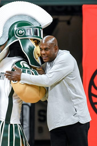 Michigan State football coach Mel Tucker hugs Sparty during a broadcast of ESPN's College GameDay on Saturday, Feb. 15, 2020, at the Breslin Center in East Lansing.