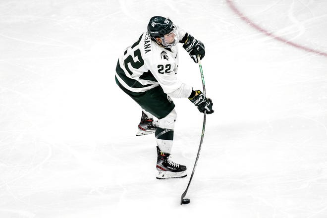 Michigan State's Dennis Cesana takes a shot during the third period on Friday, Feb. 14, 2020, at the Munn Ice Arena in East Lansing.