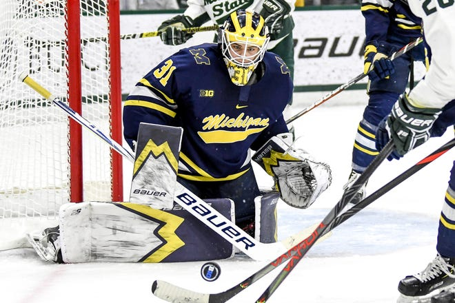 Michigan's goalie Strauss Mann watches the puck closely during the second period on Friday, Feb. 14, 2020, at the Munn Ice Arena in East Lansing.