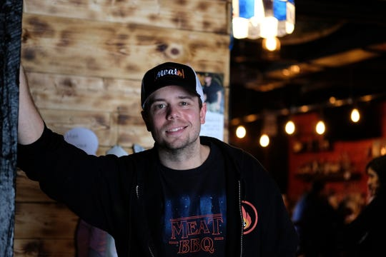 Tate Skiba, general manager of Meat in Lansing's Old Town, stands in the lobby area of the popular restaurant, Thursday, Feb. 13, 2020.