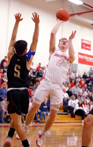 Laingsburg's Gabe Hawes, right, goes up for a shot against Potterville's Ethan Dunning (5), Friday, Feb. 14, 2020, in Laingsburg, Mich. Laingsburg won 76-74.