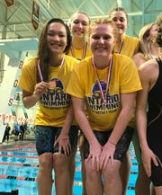 Ontario's 200 free relay team of Amy Evans, Ava Ruhe, Tiffany Whittaker and Brienne Trumpower won a district championship with a time of 1:40.02.