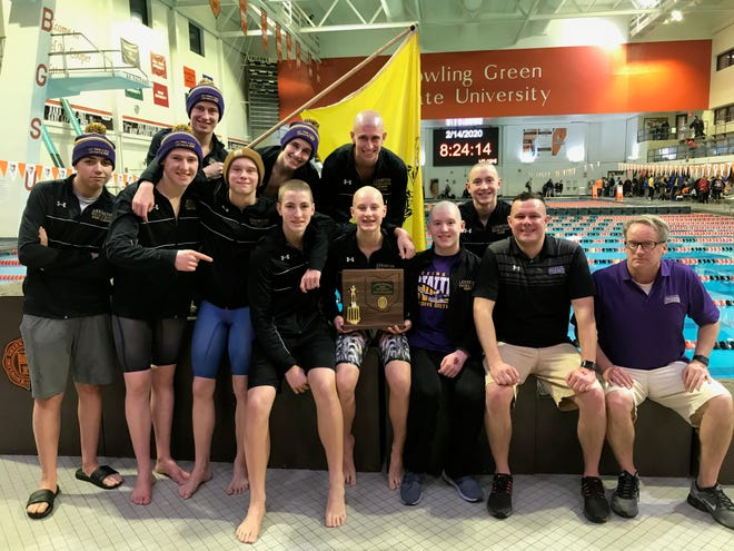Head coach Brock Spurling, second from right, and his Lexington Minutemen won their third straight Division II district title on Friday night at Bowling Green State University.