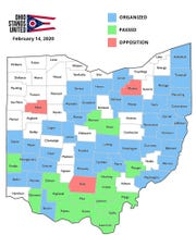 """This map of Ohio shows counties where Ohio Stands United is active. Green-shaded areas indicate counties where boards of county commissioners have passed resolutions declaring that county a """"Constitutional 2nd Amendment County."""" Counties shaded in blue have active Ohio Stands United chapters, but county commissioners have not passed resolutions yet. Red-shaded counties indicate areas where resolutions have been rejected."""