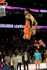 Team USA guard Ja Morant, of the Memphis Grizzlies, goes up for a dunk against Team World during the second half of the NBA Rising Stars basketball game in Chicago, Friday, Feb. 14, 2020. (AP Photo/Nam Y. Huh)