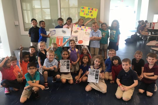 Afterschool children promote the Y's upcoming participation in the major countywide fundraiser, Give Where You Live Collier.