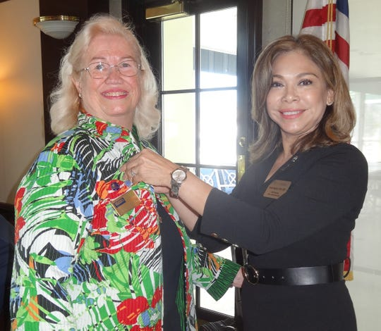 Realtor Anne McDonald was recognized for achieving Realtor Emeritus Status for 40 years in the industry. MIAAOR president Ileana Bogaert gives Anne her pin.