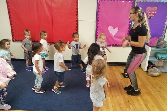 Aquatics, sports and specialty camps director Morgan Joseph instills the importance of physical activities to some of the Y's early learners (pre-school).