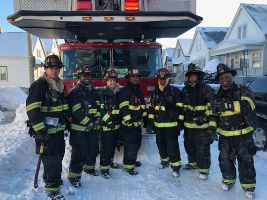 Firefighter Darrin Jones, far right, poses with members of Engine 12 after putting out a structure fire. Jones died on Feb. 1.
