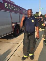 Firefighter Darrin Jones poses near rescue rig number 2.  Jones died on Feb. 1.
