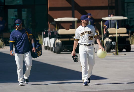 Brewers relief pitcher Corbin Burnes (right) had Lasik surgery in the offseason.