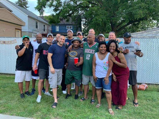Darrin Jones, wearing the Milwaukee Bucks jersey, celebrates his birthday with family and friends of the Milwaukee Fire Department.