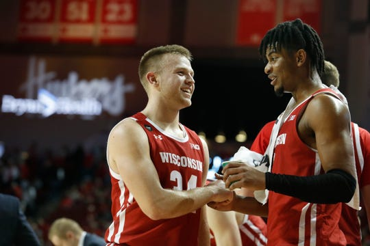 Brad Davison (left) in congratulated by Aleem Ford after tying UW's single-game record with 8 three-pointers during the Badgers' victory over Nebraska.