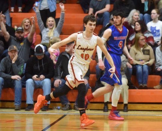 Viola's Gage Harris celebrates after knocking down a 3-pointer during the Longhorns' 79-68 victory over Hillcrest.