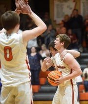 Viola senior Brandon Martin and teammate Luke Worsham watch the clock tick to zero at the end of their win over Hillcrest on Friday night.