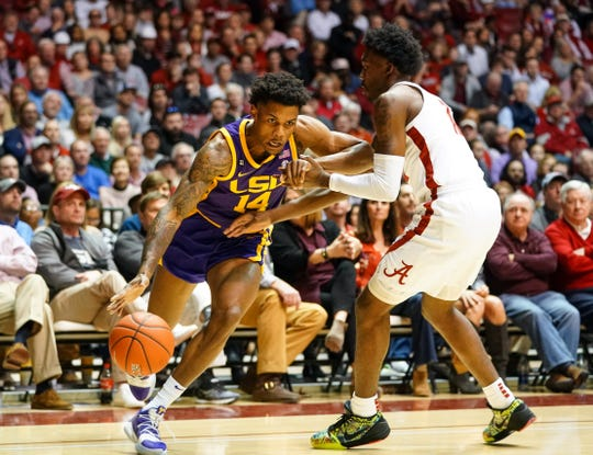 Feb 15, 2020; Tuscaloosa, Alabama, USA; LSU Tigers guard Marlon Taylor (14) drives to the basket against Alabama Crimson Tide guard Jaylen Forbes (12) during the first half at Coleman Coliseum. Mandatory Credit: Marvin Gentry-USA TODAY Sports