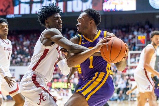Alabama guard Kira Lewis Jr. (2) defends as LSU guard Javonte Smart (1) attacks during the first half of an NCAA college basketball game, Saturday, Feb. 15, 2020, in Tuscaloosa, Ala. (AP Photo/Vasha Hunt)