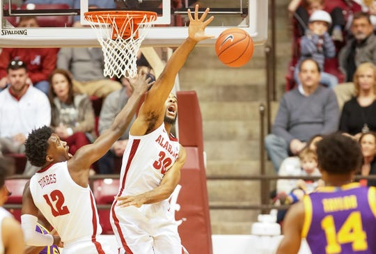 Feb 15, 2020; Tuscaloosa, Alabama, USA; Alabama Crimson Tide forward Galin Smith (30) goes after a rebound against LSU Tigers during the first half at Coleman Coliseum. Mandatory Credit: Marvin Gentry-USA TODAY Sports