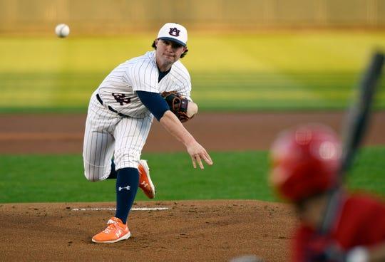 Auburn right-hander Tanner Burns throws a pitch against Illinois-Chicago on Friday, Feb. 14, 2020 in Auburn, Ala.