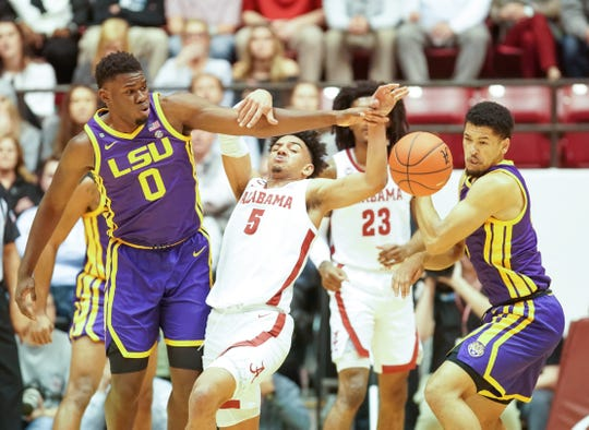 Feb 15, 2020; Tuscaloosa, Alabama, USA; Alabama Crimson Tide guard Jaden Shackelford (5) gets tangled up with LSU Tigers forward Darius Days (0) during the first half at Coleman Coliseum. Mandatory Credit: Marvin Gentry-USA TODAY Sports