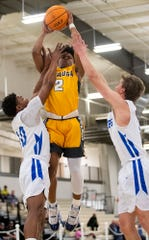 Autauga Academy's Teddy Harris (2) shoots against Lakeside's DaVantae Bowick (10) and Billy Nix (3) in AISA State Championship action in Montgomery, Ala., on Saturday February 15, 2020.