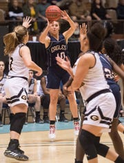 Montgomery Academy's Madi Caddell (10) takes a jump shot during the Class 3A girls Southeast Regional semifinal at Garrett Coliseum in Montgomery, Ala., on Saturday, Feb. 15, 2020.