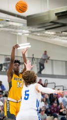 Autauga Academy's Tae Palmer (14) shoots a three point shot against Lakeside in AISA State Championship action in Montgomery, Ala., on Saturday February 15, 2020.