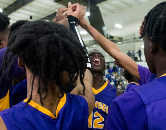 Evangel's Rashad Bailey (12) pumps up the team after the game during the AISA Class A boys state championship game at the Multiplex at Cramton Bowl in Montgomery, Ala., on Friday, Feb. 14, 2020. Evangel Christian defeated Chambers 50-40.
