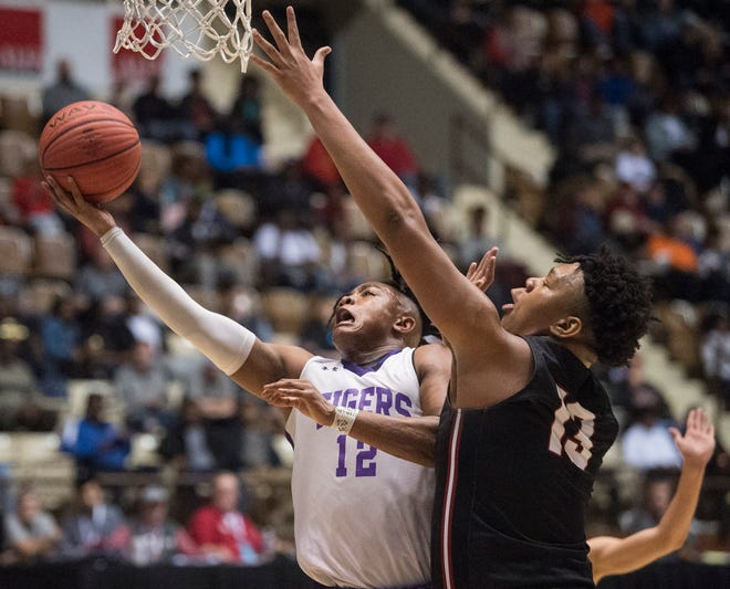 Tallassee's Tavarious Griffin (12) goes up for a layup during the Class 5A boys Southeast Regional semifinal at Garrett Coliseum in Montgomery, Ala., on Saturday, Feb. 15, 2020.