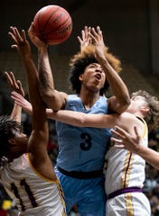 Calhoun's J.D. Davison (3) shoots J.U. Blacksher during AHSAA regional basketball action in Montgomery, Ala., on Friday February 14, 2020.