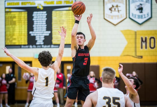 Wapahani's Tre Spence shoots a 3-pointer during their game against Monroe Central at Monroe Central High School Friday, Feb. 14, 2020.