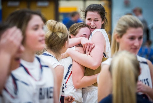 Blue River celebrates a comeback victory against North Vermillion during their regional game at Tri-Central High School Saturday, Feb. 15, 2020.