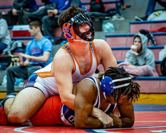 Blackman's Brooks Sacharczyk (top) and Oakland's Ketwain Bowers battle in the 182-pound championship match in the Region 5-AAA individual tournament Saturday. Sarcharczyk won by pin.