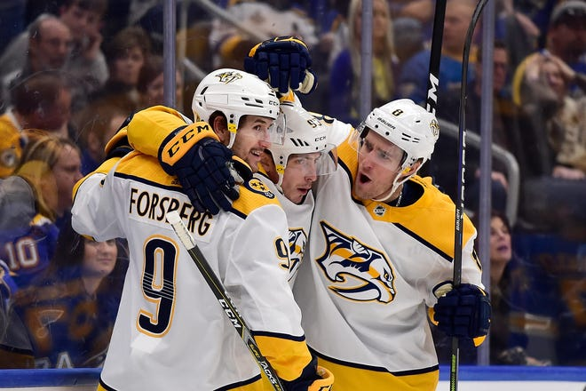 Predators center Matt Duchene (95) is congratulated by left wing Filip Forsberg (9) and center Kyle Turris (8) after scoring during the first period against the St. Louis Blues on Feb. 15.