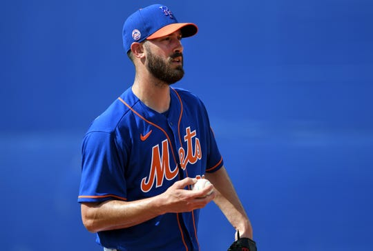 Feb 12, 2020; Port St. Lucie, Florida, USA;   New York Mets pitcher Rick Porcello (22) warms-up during the spring training workout.