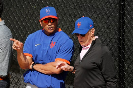 New York Mets manager Luis Rojas, left, talks with Mets owner Fred Wilpon during spring training baseball practice Saturday, Feb. 15, 2020, in Port St. Lucie, Fla.