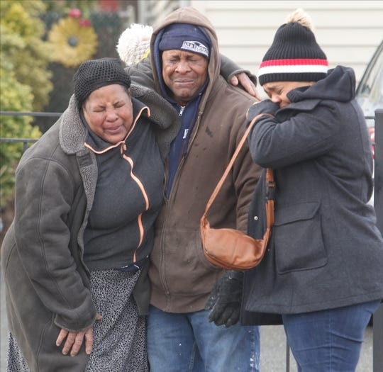 Family of fire victim Andres de Jesus Valdez, 30, mourn his death upon arriving at the scene on the corner of North 1st St. near the location of the fatal house fire.